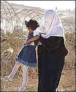Palestinian woman with child