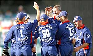 England bowler Andy Caddick is congratulated after taking the wicket of Sri Lankan captain Sanath Jayasuriya