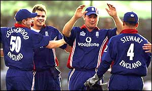 James Anderson is congratulated by team-mates