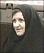 Sister Anastasija,  of Pec, beside an armoured car