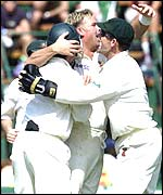 Shane Warne is mobbed by team-mates