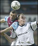 West Ham's Nigel Winterburn and Bolton's Henrik Pedersen