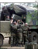 French troops load mortars and equipment on trucks