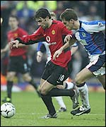 Ruud van Nistelrooy is closely watched by Blackburn defender Craig Short