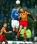 Lovenkrands and Craigan contest a high ball