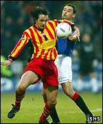 Gerry Britton holds off Alan Hutton