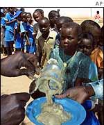 Schoolchildren getting food aid