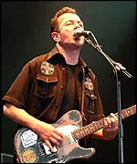 Joe Strummer and the Mescaleros performing live on stage at the Fleadh 2002 Music festival