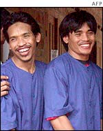 Two key Bali suspects in custody, brothers Mukhlas (left) and Amrozi