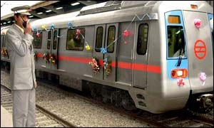 Metro official flags off a gleaming new train