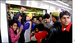 Passengers on a crowded metro platform
