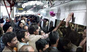 Passengers rush to board a metro train