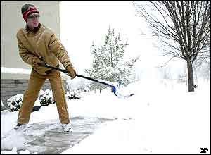 Man clearing snow from the pavement in Bella Vista,  Arkansas