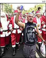 Chavez supporters march through Caracas