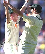 Jason Gillespie celebrates with Andy Bichel