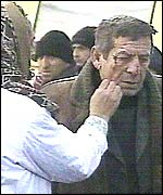 A woman cleans blood off a man's face after the bombing in Grozny.  Picture: TVS television channel