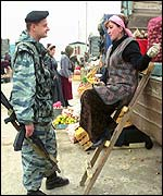 Russian soldier at market in Znamenskoye
