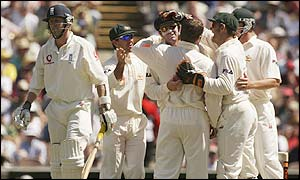 Australia's players celebrate the dismissal of England night-watchman Richard Dawson