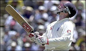 John Crawley look sto the sky after mistiming a pull shot to Justin Langer