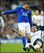 Bolton's Ivan Campo tackles Everton's Wayne Rooney