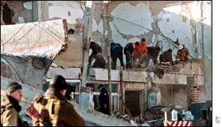 Rescue workers combing through the rubble of the headquarters of the government in Chechnya.