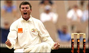 Australian spinner Stuart MacGill roars with delight after capturing the wicket of Michael Vaughan