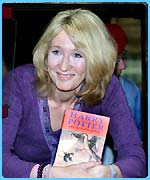JK Rowling with a copy of The Goblet of Fire