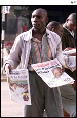 A newspaper seller reveals the election result