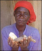 Zambian woman holding roots and barbs