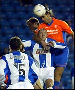 Lorenzo Amoruso rises to get in a header on goal