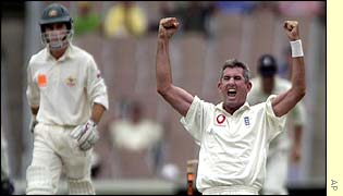Andrew Caddick celebrates taking the wicket of Justin Langer