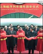 Chinese Premier Zhu Rongji (2nd R) and German Chancellor Gerhard Schroeder (2nd L) attend the ribbon-cutting ceremony