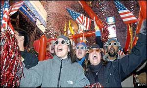 Partygoers celebrate the arrival of 2003 in New York's Time Square