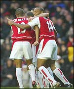 Arsenal's players mob Bergkamp