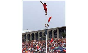 People climb flagpole outside parliament [photo: AP]