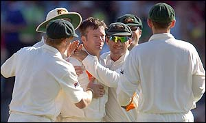 Australian captain Steve Waugh is congratulated by team mates after he has Key lbw in his first over
