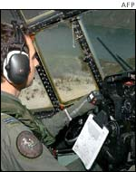 Australian air force crew assesses damage inflicted by the cyclone