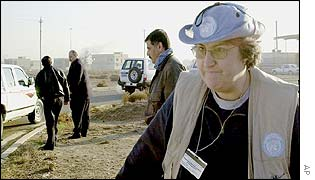 A UN inspector leaves the Al Fath company site, west of Baghdad
