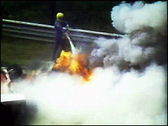 Lauda's burning car is put out