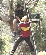 A person is winched from the chairlift