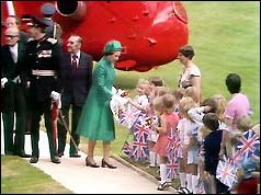 Queen Elizabeth is greeted by schoolchildren at Hillsborough