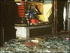 Broken glass and other damage to shopfront