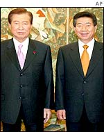 South Korean President Kim Dae-jung and successor Roh Moo-hyon