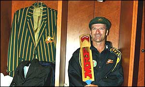 Steve Waugh smiles as he sits in the Australian dressing room after scoring his 10,000th Test run