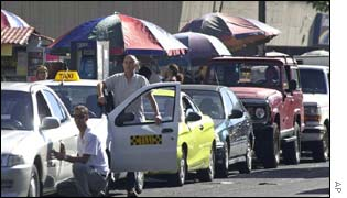 Drivers in Caracas queuing up for petrol