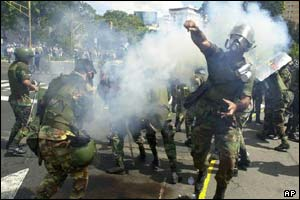National Guard soldiers throw tear gas to prevent clashes between opposition protesters and supporters of President Hugo Chavez
