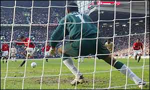Rudd van Nistelrooy scores a penalty for Man Utd past Portsmouth's Shaka Hislop