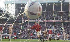 Ruud van Nistelrooy scores a penalty against Portsmouth