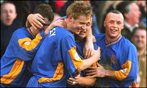 Nigel Jemson is congratulated by team-mates