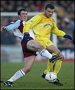 Mark Viduka shields the ball from Scunthorpe's Clifford Byrne